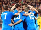 Slovenia's forward Milivoje Novakovic (2nd L) celebrates with his teammates after scoring during the Euro 2016 Group E qualifying football match Lithuania vs Slovenia in Kaunas, Lithuania on October 12, 2014