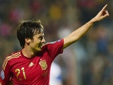 Spain's David Silva celebrates after scoring during the Group C Euro 2016 qualifying football match Luxembourg vs Spain at the Josy Barthel stadium in Luxembourg, on October 12, 2014.