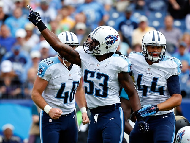 Quentin Groves #53 of the Tennessee Titans reacts to a defensive stop during the first quarter of a game against the Jacksonville Jaguars at LP Field on October 12, 2014