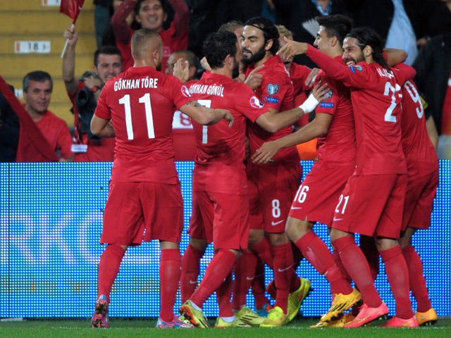 Turkey's forward Umut Bulut celebrates with teammates after scoring against Czech Republic during the UEFA Euro 2016 Group A qualifying football match between Turkey and Czech Republic on October 10, 2014