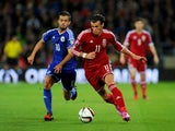 Wales striker Gareth Bale races past Bosnia player Miralem Pjanic during the EURO 2016 Qualifier match between Wales and Bosnia and Herzegovina at Cardiff City Stadium on October 10, 2014