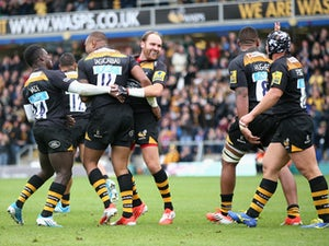 Wasps celebrate after Sailosi Tagicakibau scores a try during the Aviva Premiership match between Wasps and Bath at Adams Park on October 12, 2014