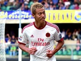 AC Milan's Japanese forward Keisuke Honda celebrates after scoring during the Italian Serie A football match Verona vs AC Milan at the Bentegodi Stadium in Verona on October 19, 2014
