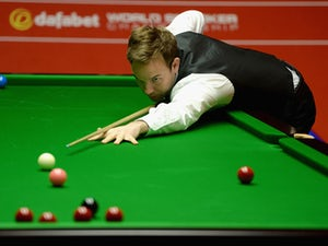 Ali Carter in action against Mark Selby during the second round of The Dafabet World Snooker Championship at Crucible Theatre on April 25, 2014