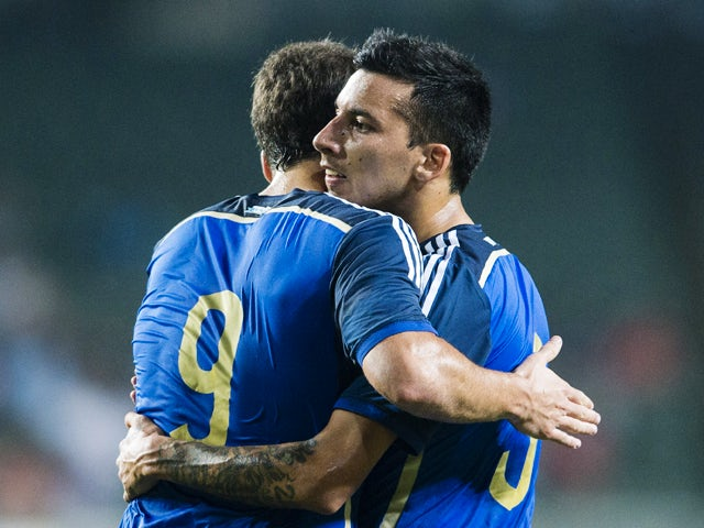 Gonzalo Higuain of Argentina celebrates with team mate Leonel Vangioni after scoring during the International Friendly Match between Hong Kong and Argentina at the Hong Kong Stadium on October 14, 2014