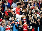 Alexis Sanchez of Arsenal celebrates after scoring the opening goal during the Barclays Premier League match between Arsenal and Hull City at Emirates Stadium on October 18, 2014