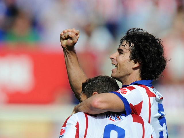Tiago Mendes of Club Atletico de Madrid celebrates after scoring his team's opening goal during the La Liga match between Club Atletico de Madrid and RCD Espanyol at Vicente Calderon Stadium on October 19, 2014