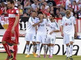 Leverkusen's forward Stefan Kiessling, Turkish midfielder Hakan Calhanoglu, South Korean forward Heung-Min Son and midfielder Karim Bellarabi celebrate after Son scored during the German First division Bundesliga football match VfB Stuttgart vs Bayer 04 L