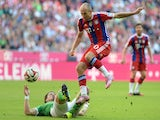 Bayern Munich's Dutch midfielder Arjen Robben and Bremen's Austrian defender Sebastian Proedl challenge for the ball during the German First division Bundesliga football match FC Bayern Munich vs Werder Bremen on October 18, 2014