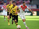 Dortmund's midfielder Ilkay Gundogan and FC Koln's Slovak midfielder Dusan Svento vie for the ball during the German First division Bundesliga football match 1 FC Koln vs Borussia Dortmund on October 18, 2014