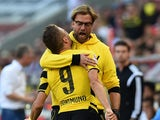 Dortmund's head coach Jurgen Klopp and Dortmund's Italian striker Ciro Immobile celebrate during the German First division Bundesliga football match 1 FC Koeln vs Borussia Dortmund on October 18, 2014