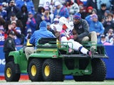C.J. Spiller #28 of the Buffalo Bills is carted off the field after an injury against the Minnesota Vikings during the first half at Ralph Wilson Stadium on October 19, 2014