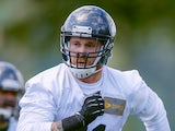 Defensive end Cassius Marsh #91 of the Seattle Seahawks defends during Rookie Minicamp at the Virginia Mason Athletic Center on May 17, 2014