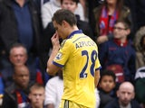Chelsea's Spanish defender Cesar Azpilicueta leaves the pitch after being shows the red card during the English Premier League football match between Crystal Palace and Chelsea at Selhurst Park in south London on October 18, 2014