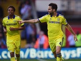 Cesc Fabregas of Chelsea celebrates with Loic Remy as he scores their second goal during the Barclays Premier League match between Crystal Palace and Chelsea at Selhurst Park on October 18, 2014
