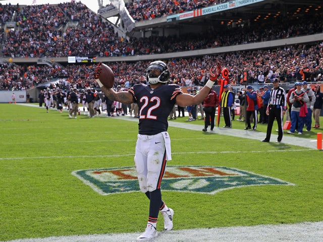 Matt Forte #22 of the Chicago Bears celebrates his third-quarter touchdown during a game against the Miami Dolphins at Soldier Field on October 19, 2014