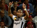 Guingamp's French midfielder Claudio Beauvue celebrates after scoring during their French L1 football match Lille vs Guingamp on October 18, 2014