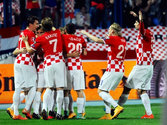 Croatia's players celebrate after scoring a goal during the Euro 2016 group H qualifying football match Croatia vs Azerbaijan at Gradskivrt stadium in Osijek, on October 14, 2014