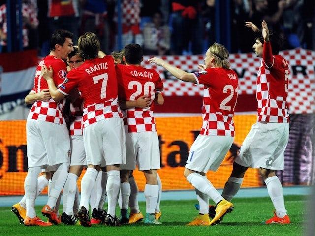 Croatia's players celebrate after scoring a goal during the Euro 2016 group H qualifying football match Croatia vs Azerbaijan at Gradskivrt stadium in Osijek, on October 14, 2014