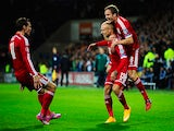Wales player David Cotterill (c) celebrates his opening goal with Gareth Bale (l) and Andy King during the EURO 2016 Qualifier match against Cyprus on October 13, 2014