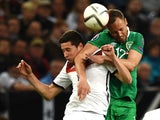 Germany's midfielder Julian Draxler and Ireland 's David Meyler vie for the ball during the UEFA Euro 2016 Group D qualifying football match Germany vs Republic of Ireland in Gelsenkirchen, western Germany on October 14, 2014