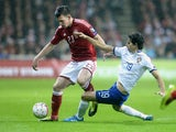 Denmark's Pierre Emile Hojbjerg and Portugal's Tiago vie for the ball during the UEFA Euro 2016 Group I qualifying football match Denmark vs Portugal in Copenhagen, Denmark on October 14, 2014