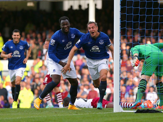 Phil Jagielka of Everton turns to celebrate after scoring the opening goal during the Barclays Premier League match between Everton and Aston Villa at Goodison Park on October 18, 2014