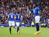 Romelu Lukaku of Everton rallies the fans as he celebrates scoring their second goal during the Barclays Premier League match between Everton and Aston Villa at Goodison Park on October 18, 2014