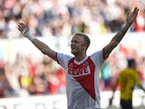 FC Koln midfielder Kevin Vogt celebrates after scoring during the German First division Bundesliga football match 1 FC Koln vs Borussia Dortmund on October 18, 2014