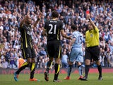 Tottenham Hotspur's Argentinian defender Federico Fazio is sent off by referee Jon Moss during the English Premier League football match between Manchester City and Tottenham Hotspur at the The Etihad Stadium in Manchester, north west England on October 1