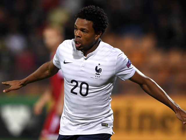 France's forward Loic Remy celebrates after scoring a goal during a friendly football match between Armenia and France at the Republican Stadium in Yerevan on October 14, 2014