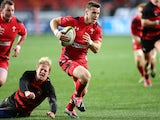 Gareth Davies of Wales slips a tackle on his way to the try line during the Incoming Tour match between EP Kings and Wales at Nelson Mandela Bay Stadium on June 10, 2014
