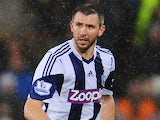 Gareth McAuley of West Bromwich Albion in action during the Barclays Premier League match against Cardiff City on October 13, 2014