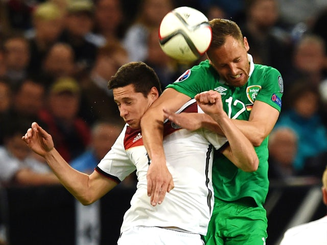 Germany's midfielder Julian Draxler (L) and Ireland 's David Meyler vie for the ball during the UEFA Euro 2016 Group D qualifying football match Germany vs Republic of Ireland in Gelsenkirchen, western Germany on October 14, 2014