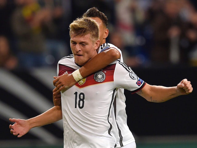 Germany's midfielder Toni Kroos and Germany�s midfielder Karim Bellarabi celebrate during the UEFA Euro 2016 Group D qualifying football match Germany vs Republic of Ireland in Gelsenkirchen, western Germany on October 14, 2014