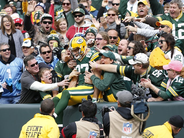 Jordy Nelson #87 of the Green Bay Packers celebrates with fans after a 59-yard touchdown pass reception in the first quarter of the game against the Carolina Panthers at Lambeau Field on October 19, 2014