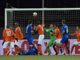 Iceland's midfielder Gylfi Thor Sigurdsson (down) scores duirng the Euro 2016 Group A qualifying football match Iceland vs the Netherlands in Reykjavik, Iceland on October 13, 2014