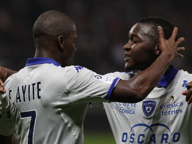 Bastia's French midfeilder Floyd Ayite (L) celebrates with Bastia's French Forward Hervin Ongenda after scoring during the French L1 football match against Nice on October 18, 2014