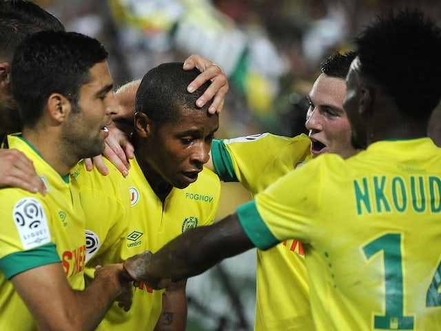 Nantes' French forward Johan Audel (C) celebrates with his teammates after scoring a goal during the French L1 football match between Nantes (FCN) and Reims (SR) on October 18, 2014