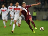 Latvia's Kaspars Dubra (R) vies with Turkey's Umut Bulut (L) during the Euro 2016 Group A qualifying football match Latvia vs Turkey in Riga, Latvia on October 13, 2014