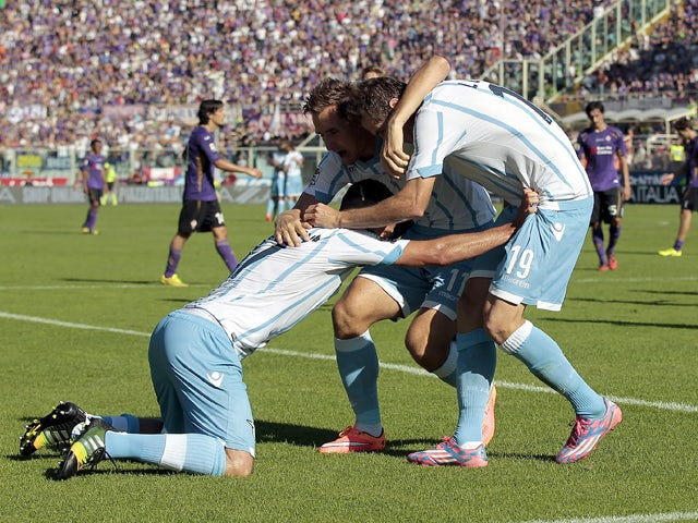 Lazio players celebrate a goal scored by Senad Lulic during the Serie A match between ACF Fiorentina and SS Lazio at Stadio Artemio Franchi on October 19, 2014