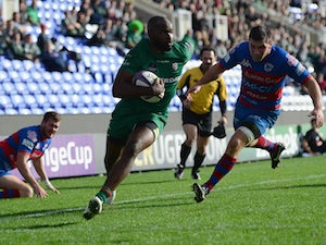 Stefan Basson of Rovigo fails to stop Topsy Ojo of London Irish from scoring a try during the European Rugby Challenge Cup match between London Irish and Rovigo at Madejski Stadium on October 19, 2014