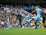 Manchester City's Argentinian striker Sergio Aguero scores their second goal from the penalty spot during the English Premier League football match between Manchester City and Tottenham Hotspur at the The Etihad Stadium in Manchester, north west England o