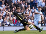 Manchester City's Argentinian striker Sergio Aguero scores his, and their fourth goal past Tottenham Hotspur's Belgian defender Jan Vertonghen during the English Premier League football match between Manchester City and Tottenham Hotspur at the The Etihad