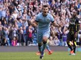 Manchester City's Argentinian striker Sergio Aguero celebrates scoring his, and their third goal from the penalty spot during the English Premier League football match between Manchester City and Tottenham Hotspur at the The Etihad Stadium in Manchester,