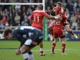 Ian Keatley of Munster celebrates withJJ Hanrahan after kicking the match winning drop goal during the European Rugby Champions Cup match between Sale Sharks and Munster at AJ Bell Stadium on October 18, 2014