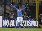 Napoli's midfielder from Spain Juan Miguel Callejon celebrates after scoring during the Italian Serie A football match Inter Milan vs Naples on October 19, 2014