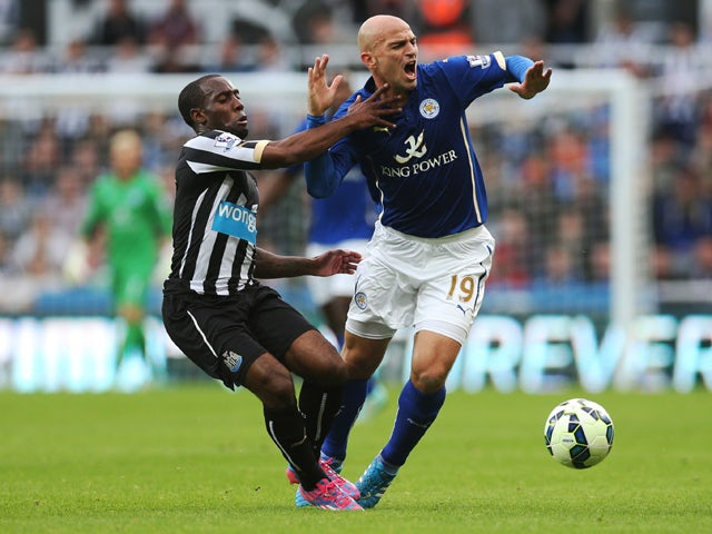 Leicester City's Argentinian midfielder Esteban Cambiasso vies with Newcastle United's Dutch midfielder Vurnon Anita during the English Premier League football match between Newcastle United and Leicester City at St James' Park in Newcastle-upon-Tyne, nor