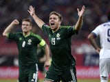 Northern Ireland's forward James Ward celebrates after scoring a goal during UEFA Euro 2016 group F qualifying gootball match between Greece and Northern Ireland at the Karaiskaki stadium in Piraeus, near Athens, on October 14, 2014