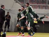 Northern Ireland's midfielder Kyle Lafferty celebrates with teammates after scoring a goal during the UEFA Euro 2016 group F qualifying gootball match between Greece and Northern Ireland at the Karaiskaki stadium in Piraeus, near Athens, on October 14, 20